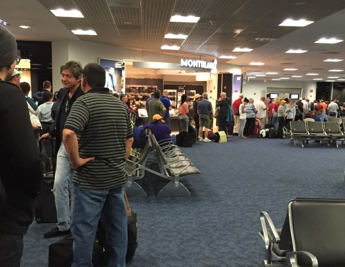 A long line at the Rebooking Center in the American Airlines terminal at Miami International Airport.