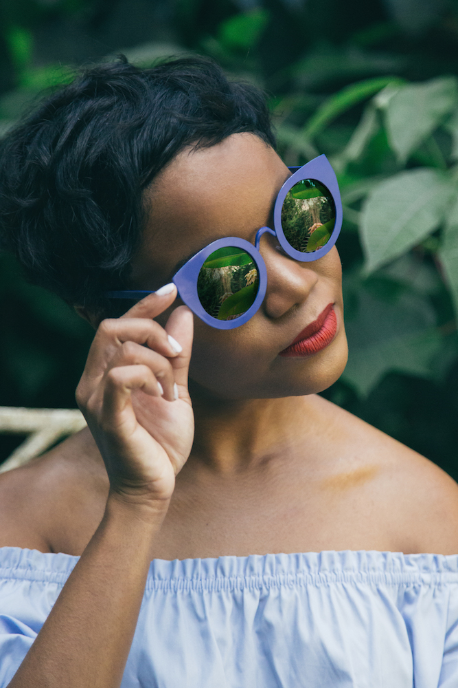 sueann-tannis-black-woman-in-garden-cobalt_blue_sunglasses