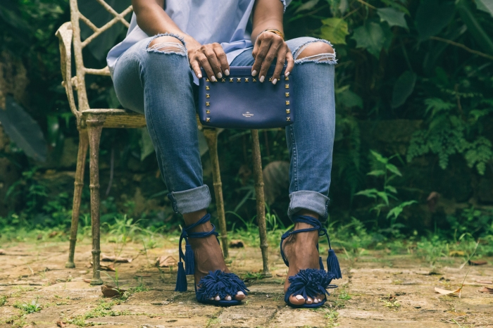 sueann-tannis-black-woman-in-garden-valentino_clutch_blue_shoes