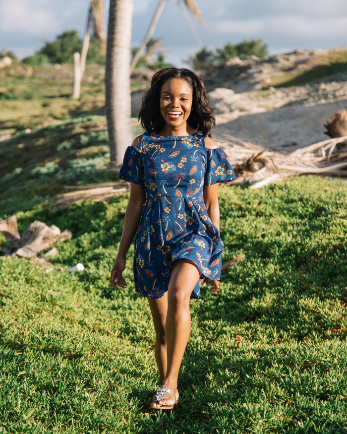 Black woman running through countryside in Barbados in the Caribbean